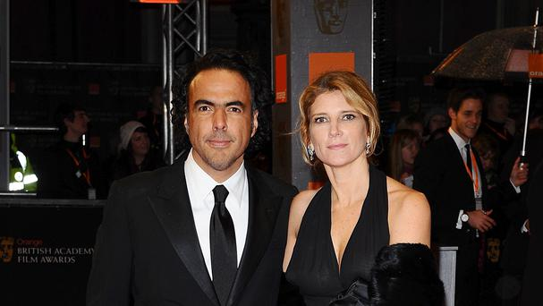 Alejandro Inarritu, pictured with his wife Maria, won the prize for outstanding directional achievement for a feature film