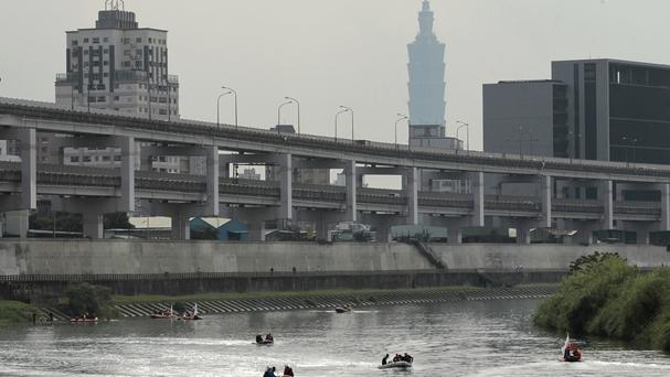 Divers on boats look for missing passengers of crashed TransAsia Airways Flight 235 in a Taipei river (AP)