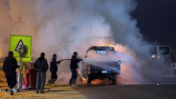 A truck was torched in a riot outside a football match in Egypt (AP/El Shorouk newspaper)