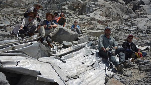 Chilean mountaineers pose on what they say is the wreckage of a plane that crashed in the Andes 54 years ago (APLeonardo Albornoz)