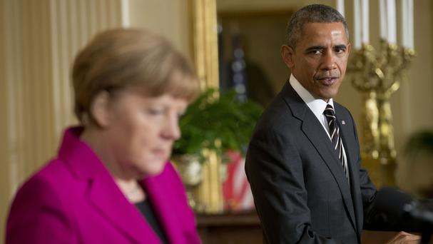 US President Barack Obama looks towards German Chancellor Angela Merkel during their joint news conference (AP)