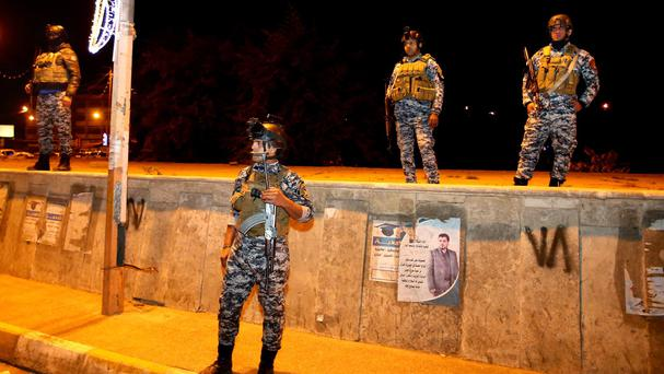 Iraqi security forces are deployed after the lifting of the night-time curfew, at Tahrir Square in Baghdad (AP)