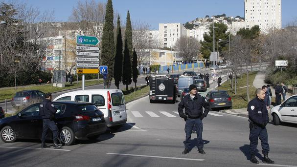 Police officers in Marseille, France, after gunmen fired automatic weapons (AP)