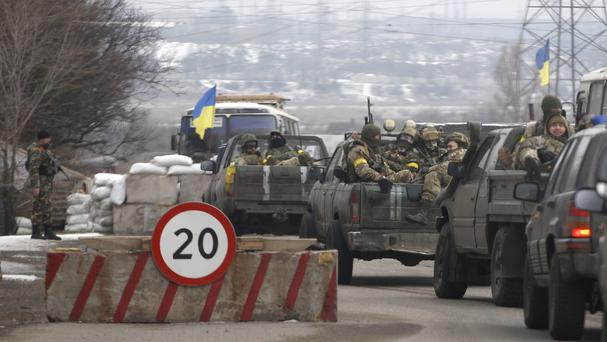 Ukrainian government troops pass a checkpoint near the town of Mariupol. (AP)