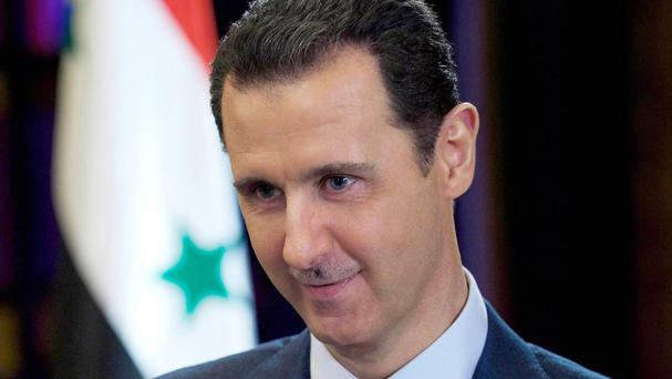 Syrian president Bashar Assad gestures during an interview with the BBC in Damascus (AP/SANA)