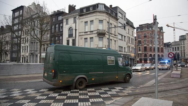 The defendants arrived in a covered van to the main courthouse in Antwerp. (AP)