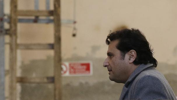 Francesco Schettino arrives to attend his trial at the Grosseto court in Italy. (AP)