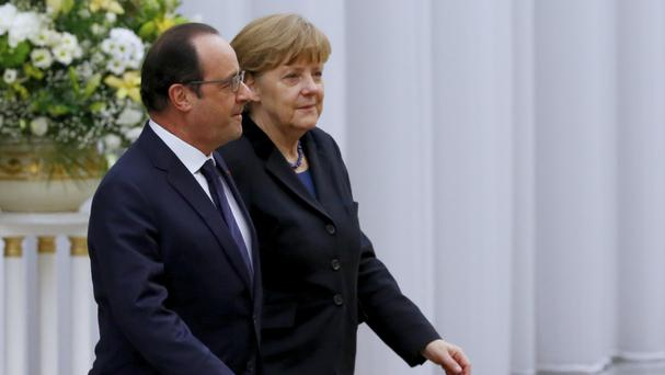 German Chancellor Angela Merkel and French President Francois Hollande head for talks in Minsk. (AP)