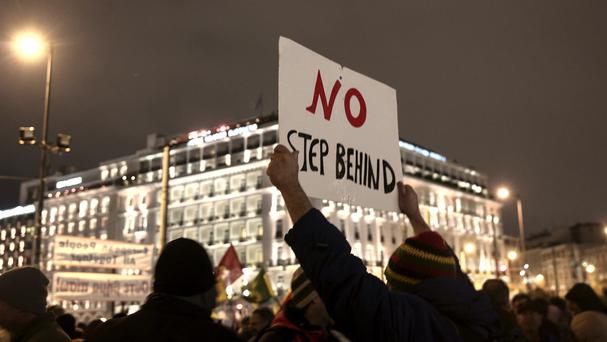 Pro-government demonstrators gather in front of Greece's parliament to back its bail-out debt renegotiation (AP)