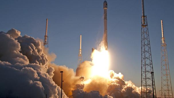 The Falcon 9 SpaceX rocket carrying the Deep Space Climate Observatory blasts off (AP)