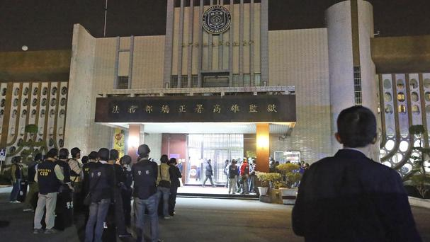 Police gather outside the prison as the hostage drama unfolds (AP)
