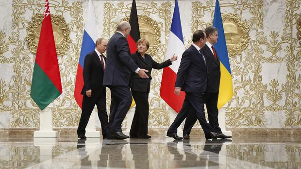 The leaders of Russia, Belarus, Germany, France and Ukraine during a break in the talks in Minsk (AP)
