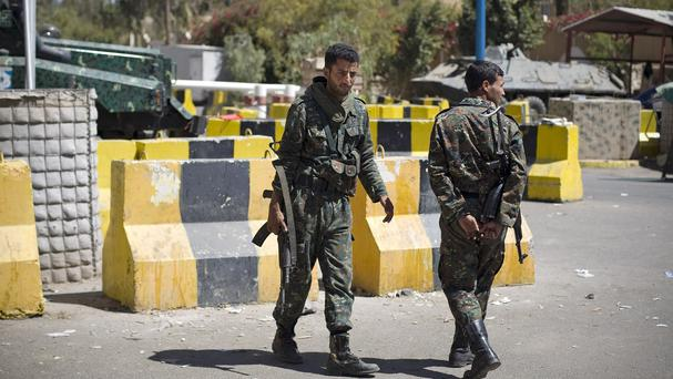 Police at the entrance of the US embassy in Sanaa. (AP)