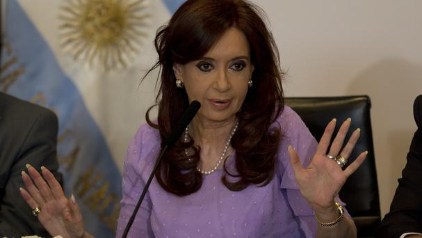 Argentina's President Cristina Fernandez speaks during an event announcing new government projects at the government palace Casa Rosada, in Buenos Aires, Argentina, Wednesday, Feb. 11, 2015. (AP Photo/Rodrigo Abd)