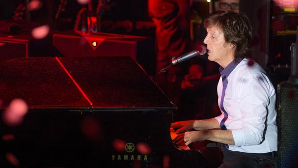 Paul McCartney and his band perform a Valentine's Day concert at Irving Plaza in New York City (Invision/AP)