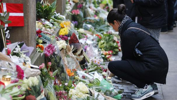 Flowers lie in front of the Copenhagen synagogue where a security guard was killed (AP)