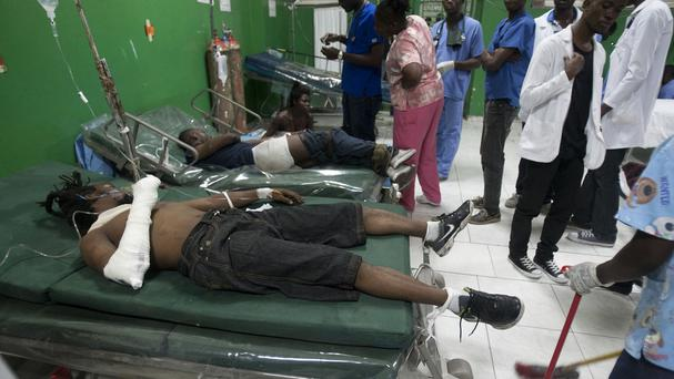Injured people receive treatment at the General Hospital in Port-au-Prince, Haiti. (AP)