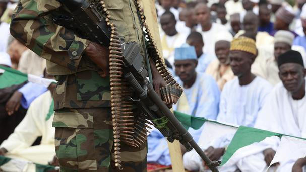 Nigerian soldiers stand guard during Eid al-Fitr celebrations in Maiduguri. (AP)