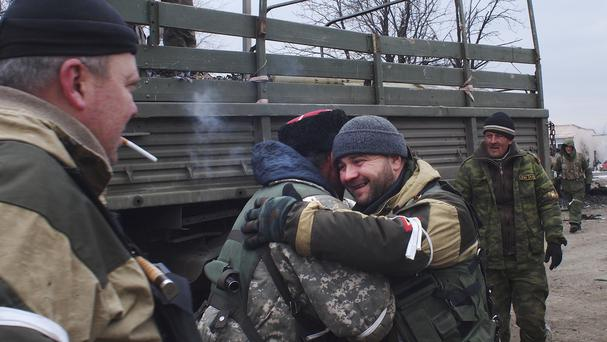 A pro-Russia rebel Cossack hugs another rebel in Debaltseve, eastern Ukraine (AP)