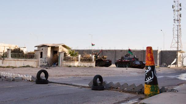 Tanks are seen outside the broadcast station in Sirte, Libya (AP)