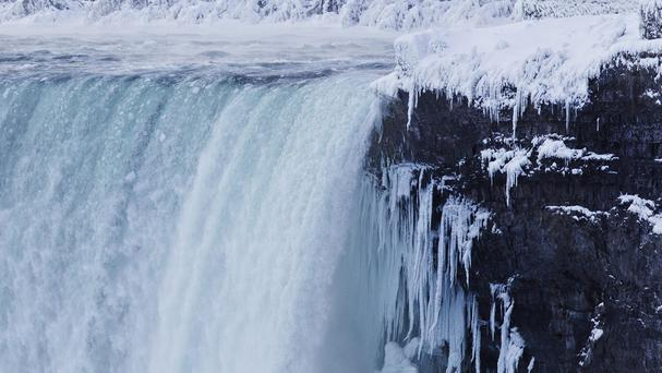 Ice formed around the Canadian 'Horseshoe' Falls in Niagara Falls (AP)
