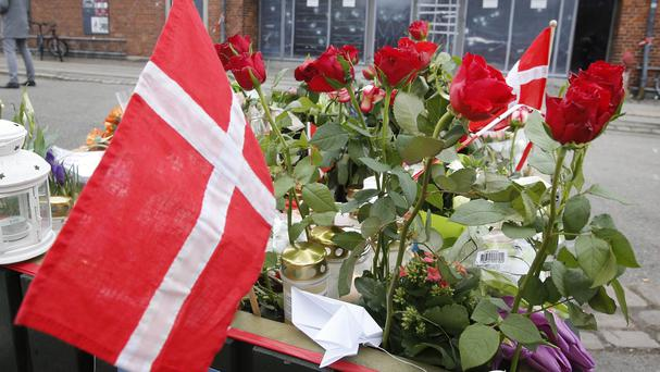 A Danish flag and roses in front of the cultural club in Copenhagen, Denmark (AP)