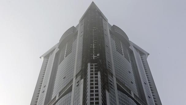Fire damage is seen on high floors of the Torch Tower after it was extinguished at Dubai's Marina district (AP)