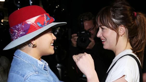 Rita Ora, left, and Dakota Johnson backstage during rehearsals for the 87th Academy Awards in Los Angeles (AP)