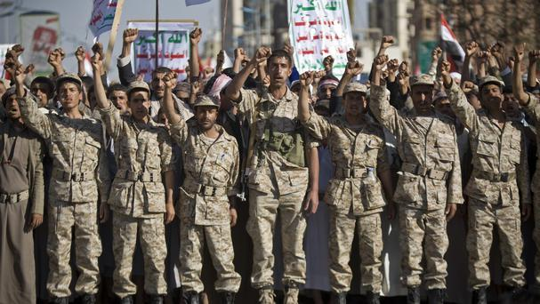 Houthi Shiite Yemenis wearing army uniforms chant slogans during a rally to show support for their comrades in Sanaa (AP)