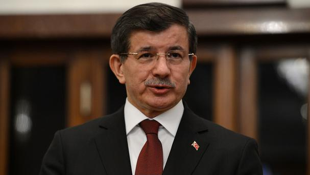 Turkish prime minister Ahmet Davutoglu said nearly 600 troops and 100 tanks and armoured personnel carriers were involved (AP)