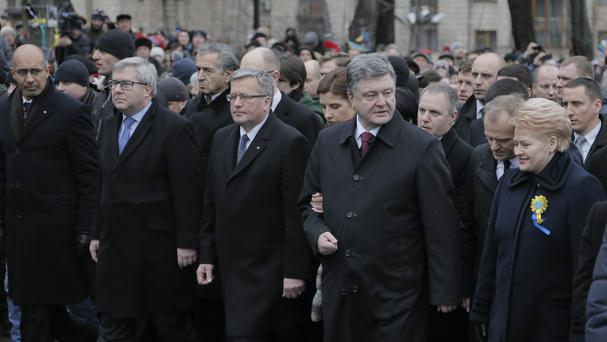 Ukrainian president Petro Poroshenko and foreign guests march in Kiev (AP)