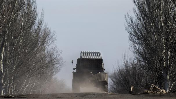 A Ukrainian multiple rocket launcher is transported towards near Artemivsk, eastern Ukraine (AP)