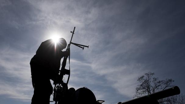 A Ukrainian soldier stands on top of a military vehicle near Artemivsk, eastern Ukraine. (AP)