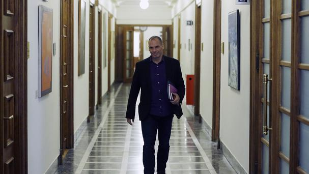 Greece's finance minister Yanis Varoufakis arrives for a meeting at the parliament in Athens. (AP Photo/Thanassis Stavrakis)