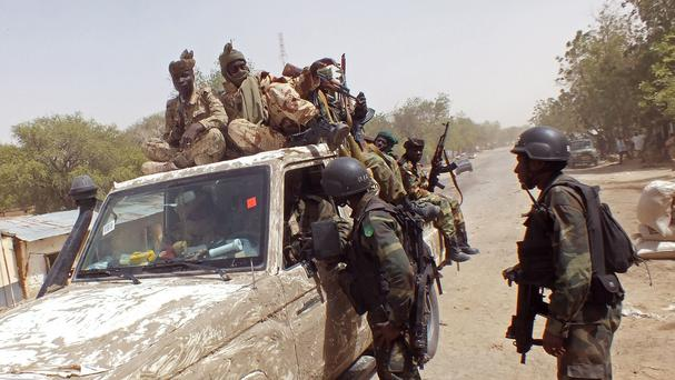 Soldiers from Cameroon and Chad form part of the force to combat Islamic extremists Boko Haram, near the town of Gambarou, Nigeria. (AP Photo/Edwin Kindzeka Moki)