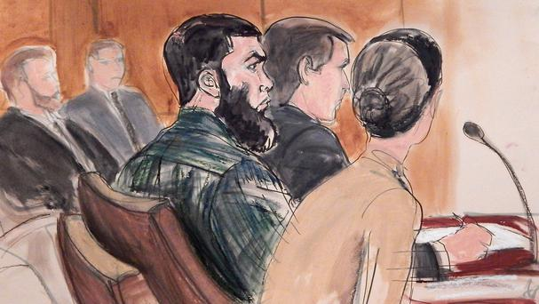 Abid Naseer, centre, is accused of being an al-Qaida operative plotting to stage attacks in England, New York and Denmark (AP)