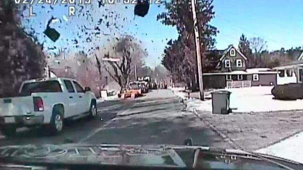Dashcam footage of natural gas explosion which levelled a home and sent debris into the air in New Jersey ((AP/Stafford Township Police Department)
