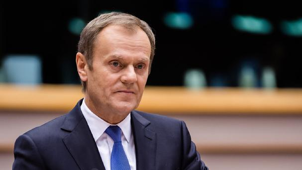 European Council president Donald Tusk has threatened more sanctions if the Ukraine ceasefire fails to hold (AP)