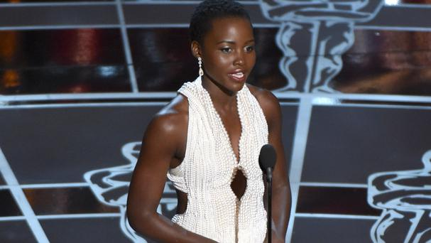 Lupita Nyong'o wears the now-stolen pearl dress as she presents an award at the Oscars in Los Angeles (Invision/AP)