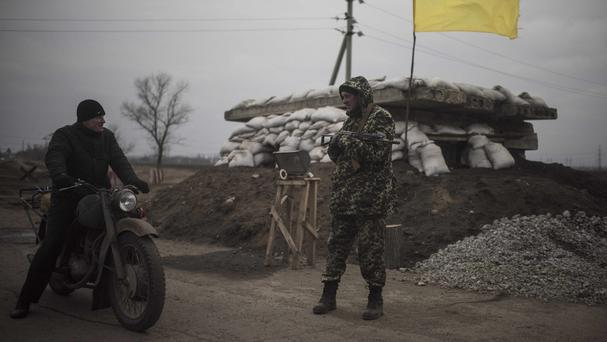 The warring sides in Ukraine have been withdrawing heavy weapons