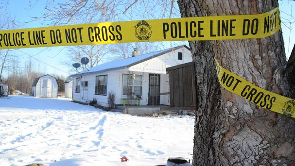 Police tape surrounds one of five crime scenes near Tyrone, Missouri, after a gunman killed seven people in a house-to-house rampage (AP)