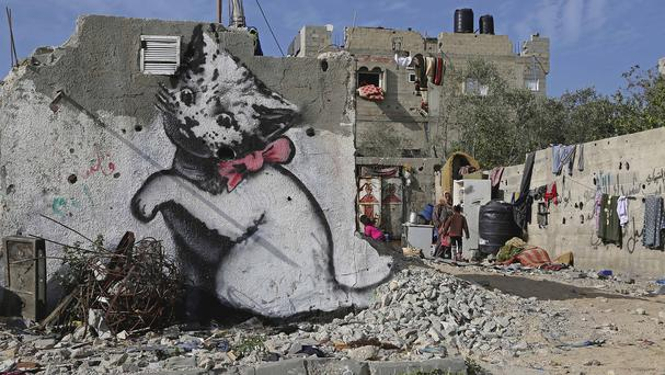 Work believed to be by Banksy is seen on a wall in Gaza (AP)