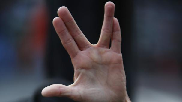 A fan gives a Vulcan salute in honour of Leonard Nimoy in Los Angeles (AP)