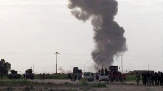 In this image made from video, smoke rises from an explosion as Iraqi forces, Shia militiamen and Sunni tribal fighters battle Islamic State militants for control of Tikrit (AP Photo via AP video)