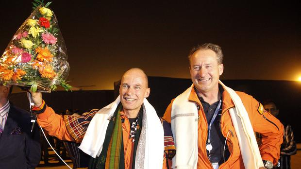Swiss pilots Bertrand Piccard, left, and Andre Boschberg acknowledge the media after landing at an airport in Ahmadabad, India. (AP Photo/Ajit Solanki)
