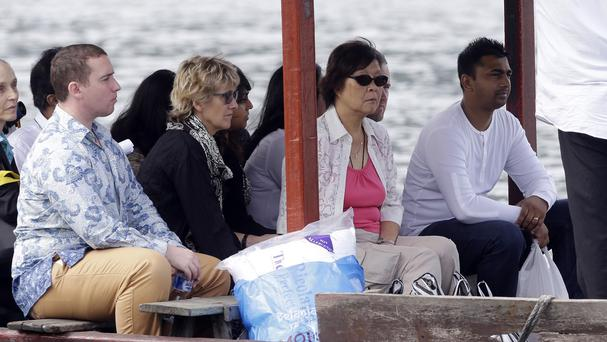 Family members of Australian death row prisoners Andrew Chan and Myuran Sukumaran head to Nusakambangan Island. (AP Photo/Achmad Ibrahim)