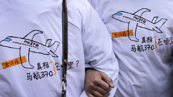 Questions remain unanswered about the fate of Malaysia Airlines Flight 370 one year ago (AP)