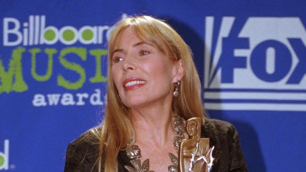 Joni Mitchell, pictured in 1995, is being treated in hospital (AP)