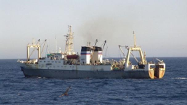 The Russian trawler sank off the Kamchatka Peninsula and more than 25 fishing boats were helping to rescue crew members