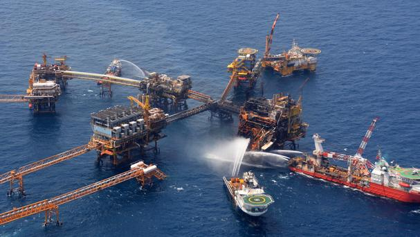 Emergency boats work to put out a fire at the Abkatun-A Permanente shallow-water oil platform in the Campeche Sound (AP/Pemex)